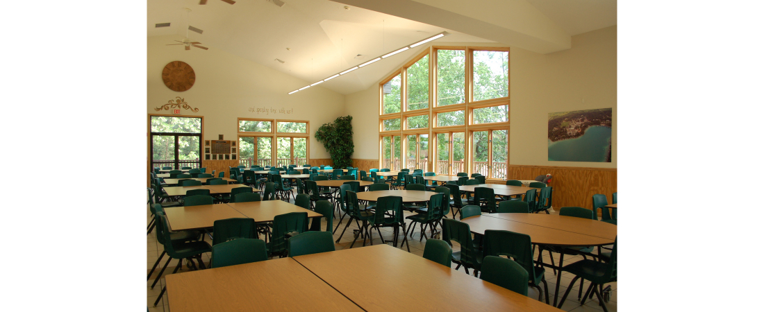 Spencer-Lake-commercial-architect_camp_Dining-Hall-Dining-room-with-tables-2-1100x450.jpg
