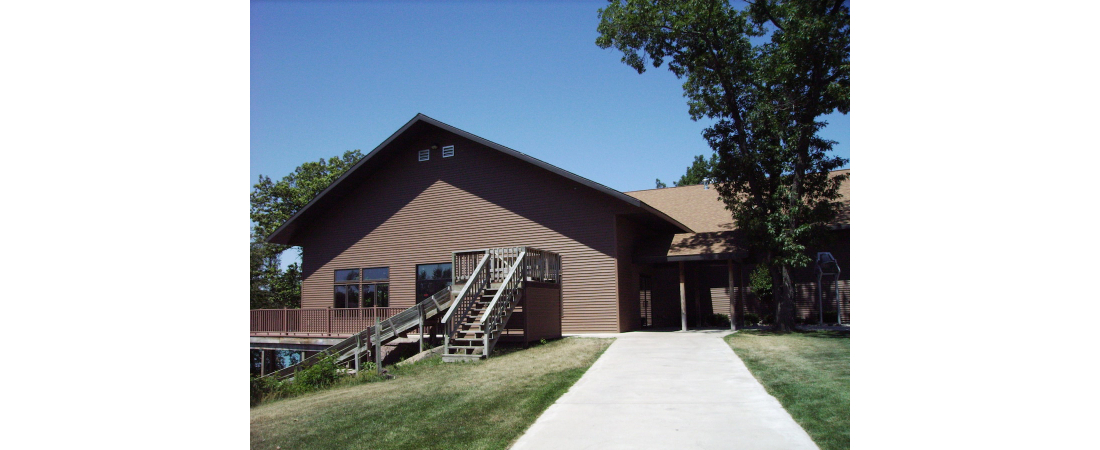 Spencer-Lake-commercial-architect_camp_Dining-Hall-exterior-side-view-1100x450.jpg