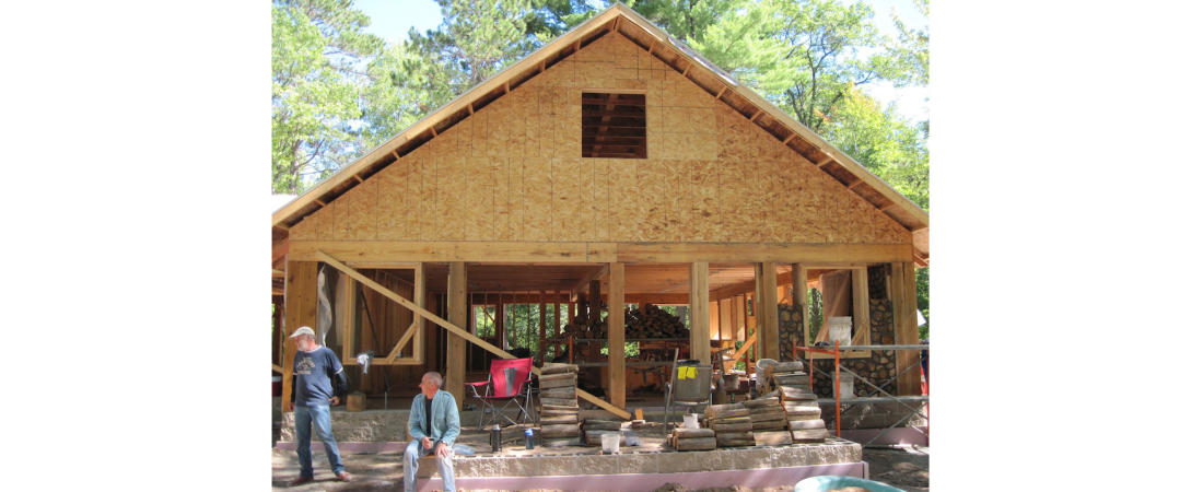 wisconsin-residential-architect_custom-home_cordwood_Exterior-Progress-View-1100x450.jpg